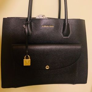 Black Michael Kors Mint Condition latest season.